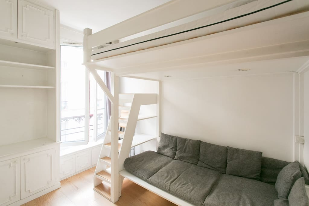 Bright living room and sofa under the bunk bed for 2
