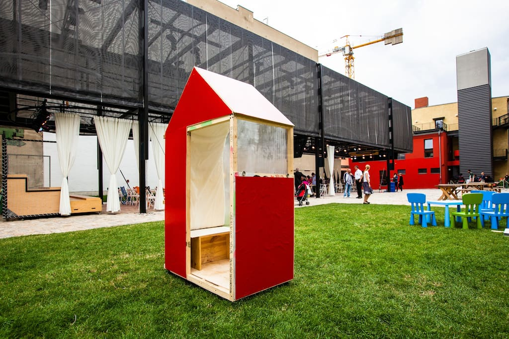 The One SQM House in front of the Guggenheim LAB, a temporary event with workshops, lectures and events.