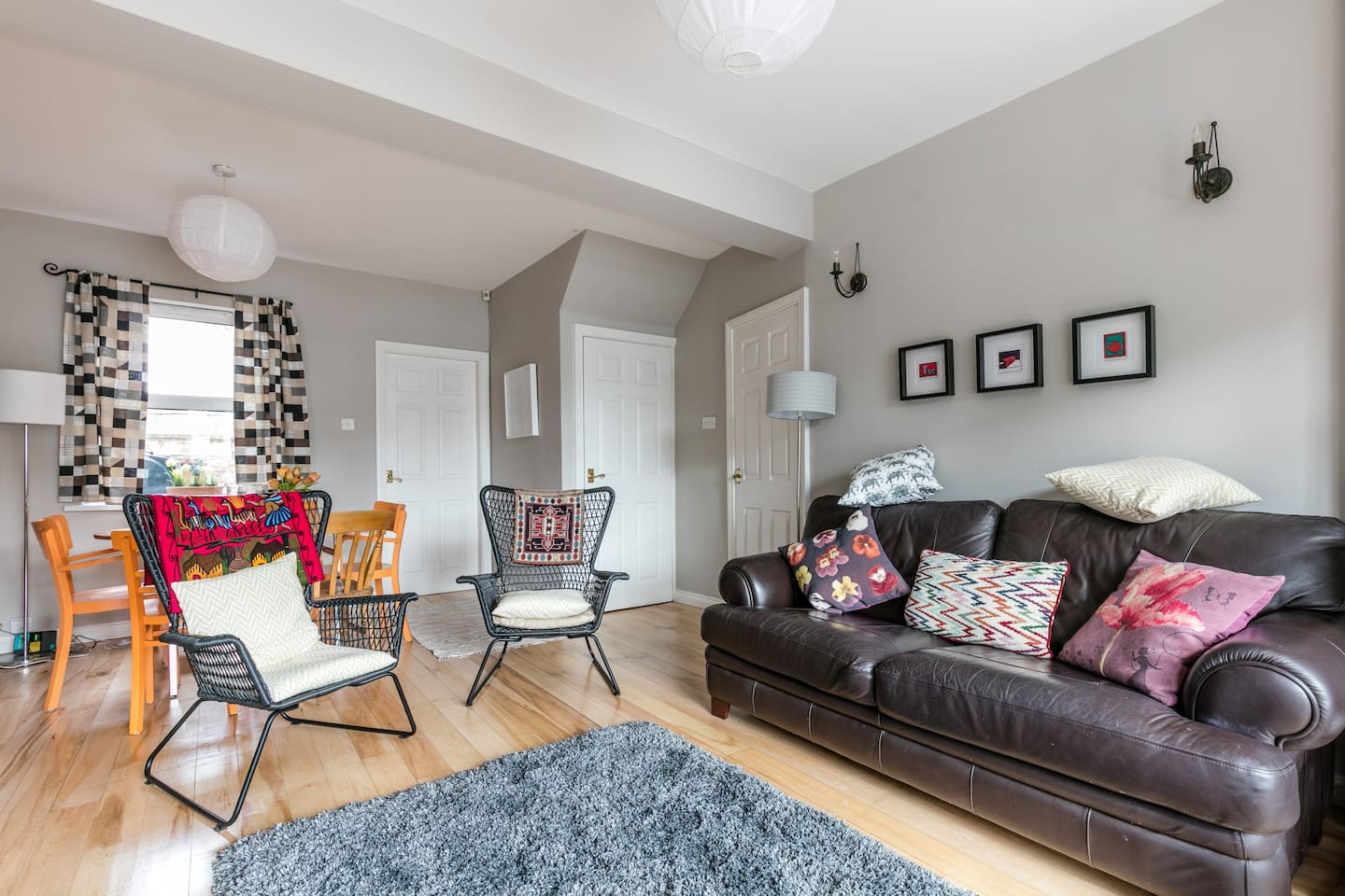 Warm, cosy but spacious living room with equally spacious dining area