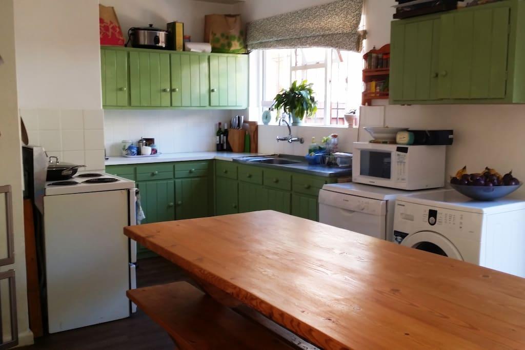 Enjoy dinner around the farmhouse kitchen.
