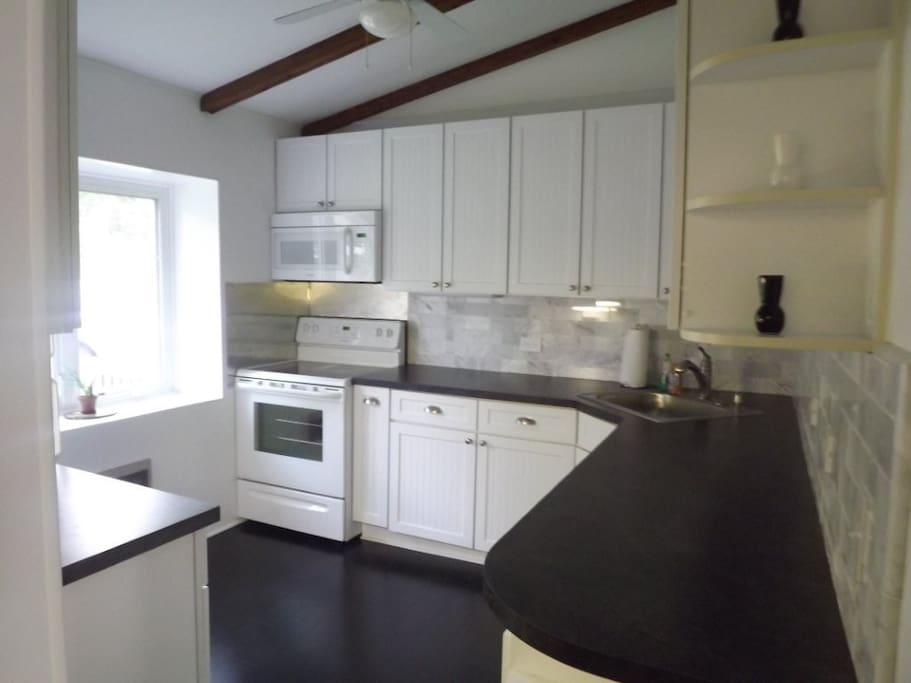New Kitchen with top-of-the-line appliances, cookware and stocked pantry