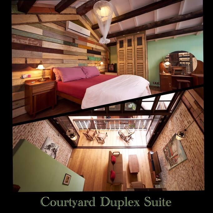 This duplex suite comprises of a loft bedroom, lounge area & private terrace.      A mid-century style queen sized teak bed.                En-suite bathroom with rain shower.