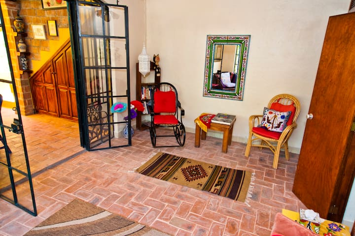 Lovely wrought iron rocker and cane armchair
