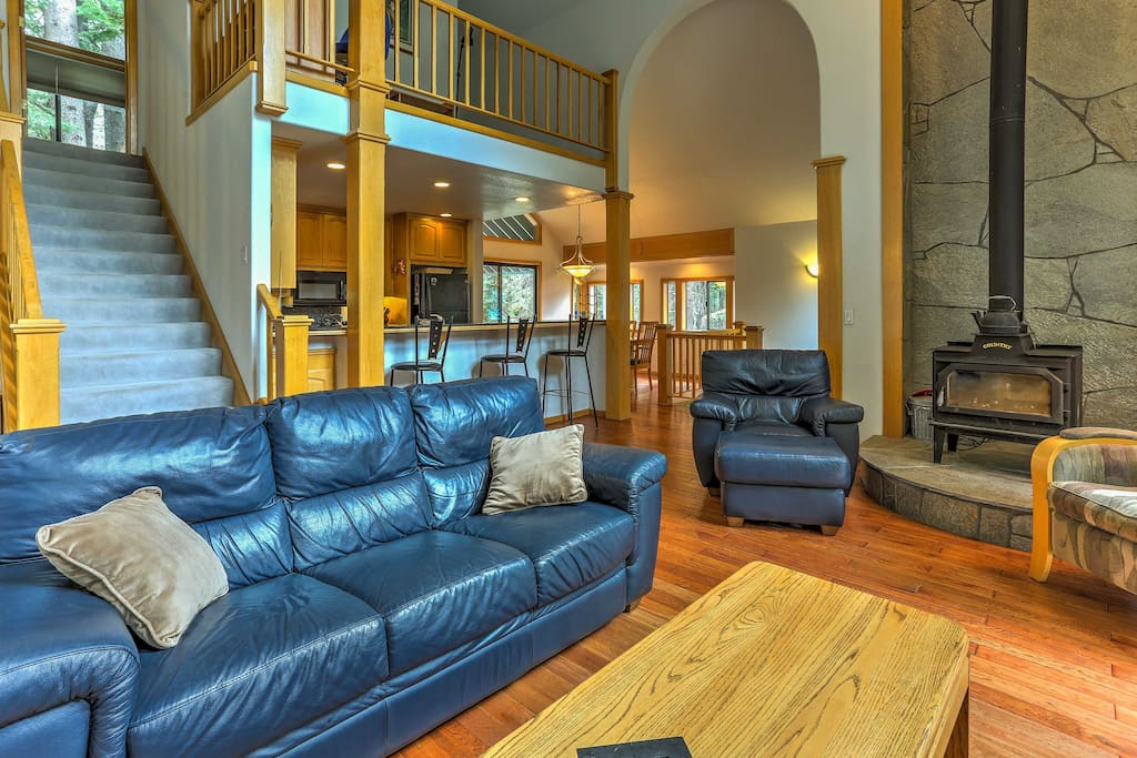 Cuddle up on one of the couches next to the wood-burning stove in the living area.