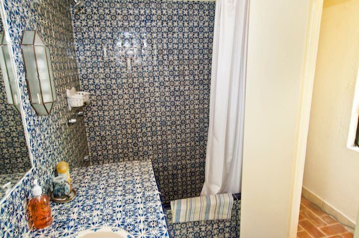 Traditional tiled bathroom with shower and tub