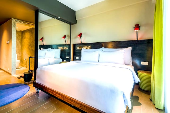 Stylish & comfortable, with custom iron furnishings, graffiti artwork and retro industrial chic light fixtures. Studio Room is 32sqm with luxury twin and king beds  ( Request on availability ) with 400 thread count cotton linens.