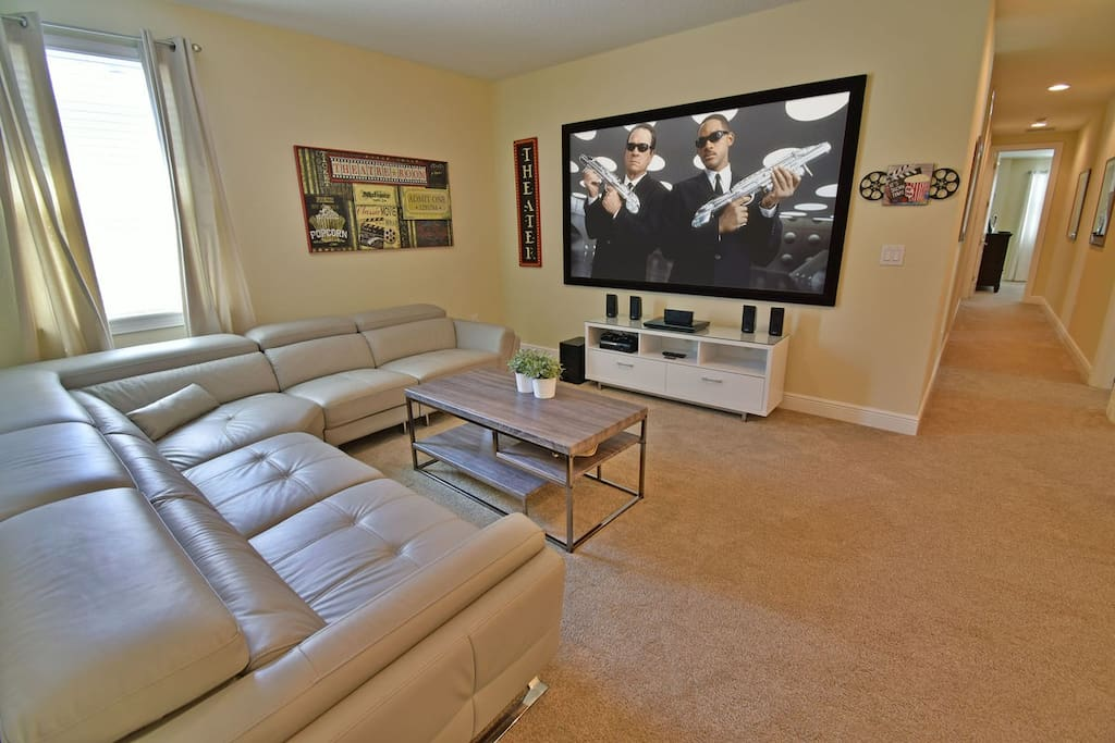 Movie theatre room with gaming console