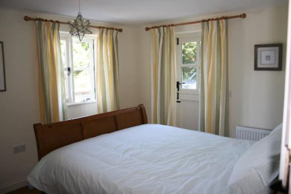 Main bedroom with king size bed and quality furnishings and linen.