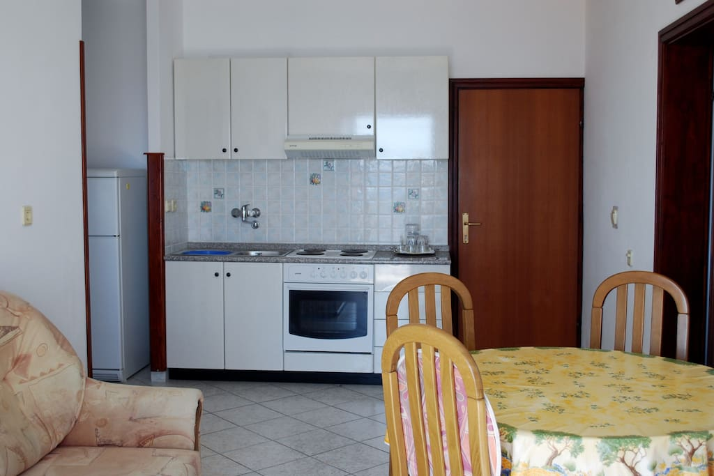 KITCHEN WITH ALL FACILITIES AND HELP BED (SOFA)
