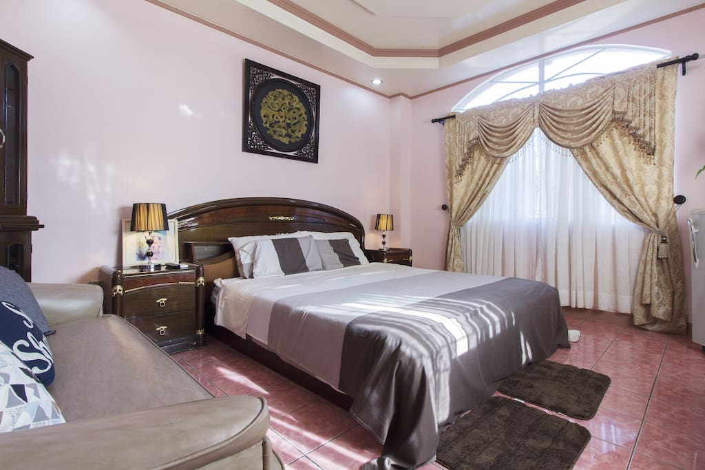 Master's bedroom ( king size bed, sofa, aircondition ,refrigerator, television with cable, walk in closet, bath and toilet)