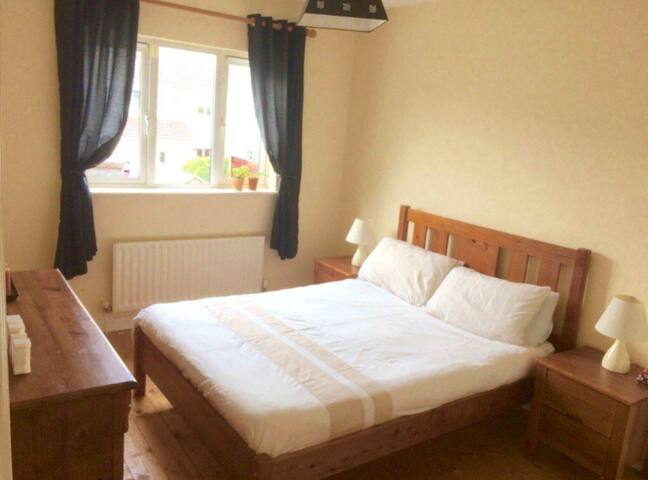 Warm friendly home , close to town and airport