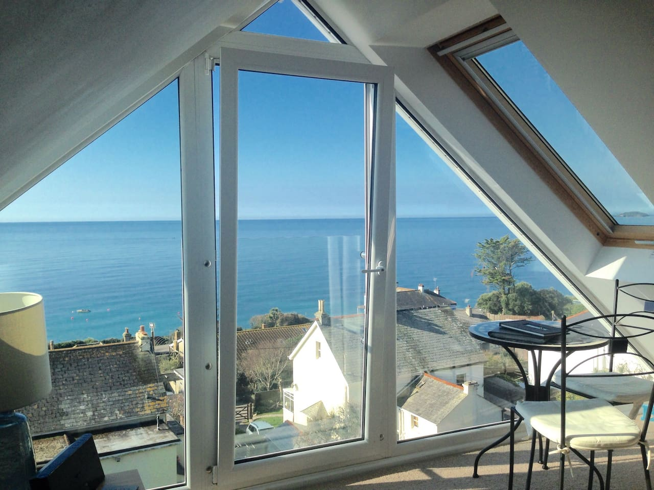 A stunning panoramic view of the sea and coastline from east to west through the south facing window.