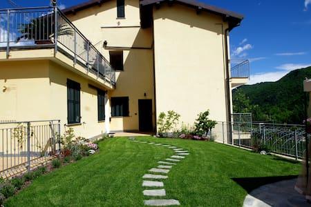 Appartamento con vista giardino N°5 - Ranzo - Квартира