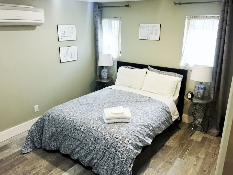 The back bedroom in soothing blue. Full bed for cuddling!