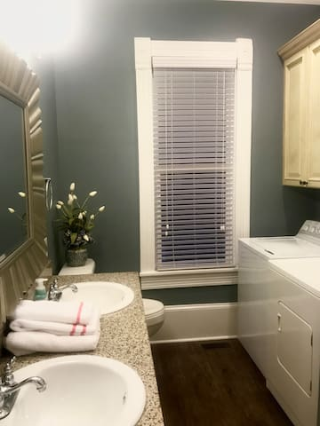 Laundry area is conveniently located in the bathroom area!
