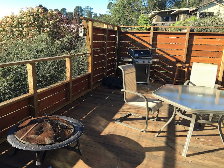 Deck with grill, patio table, fire-pit, umbrella