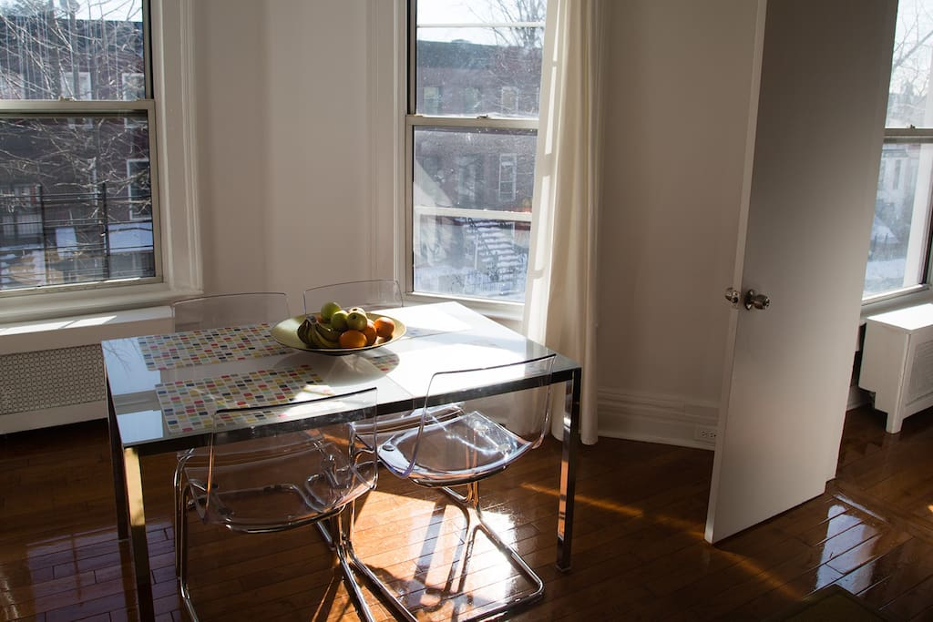 Dining are in large, sunny living room