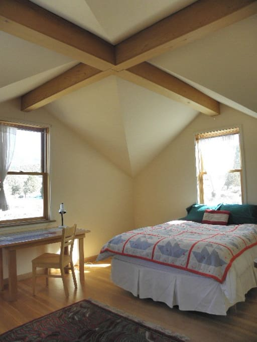 The upstairs bedroom is spacious and bright.