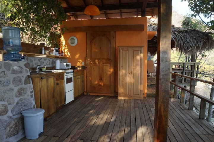The outdoor kitchen and main entrance at the guest house.