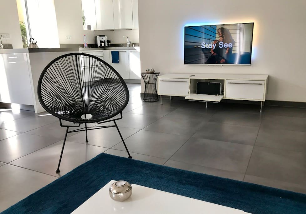 living room area - Ambilight Flatscreen with Apple TV and Sonos sound system