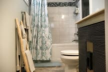 Beautiful bathroom with custom tile,  deep jet tub for relaxing and a bidet.
