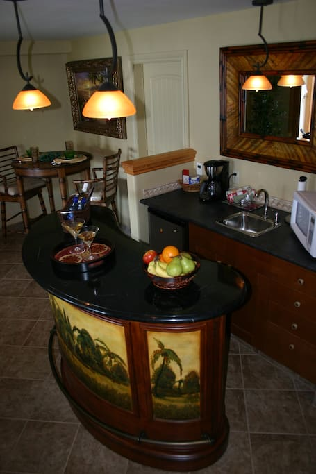 Mini kitchen area with dining area in the corner