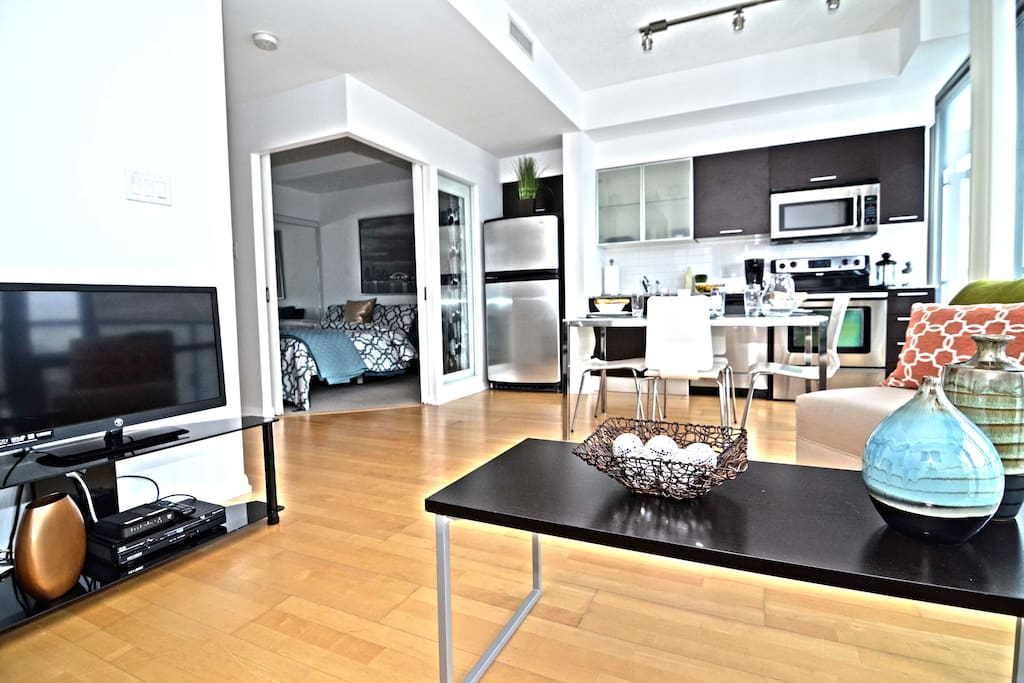 Open concept living, dining and kitchen area - floor to ceiling windows