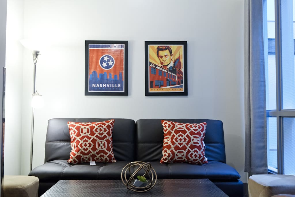 Our spacious studio has everything you need for your Nashville getaway! It features lounge area, custom artwork, lots of clothing storage, reading area, and bedroom with views of downtown Nashville.