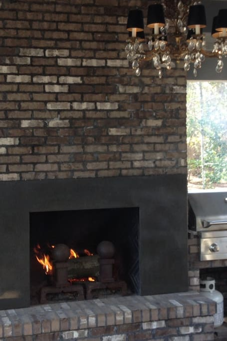 Outdoor fireplace and stainless kitchen aid grill