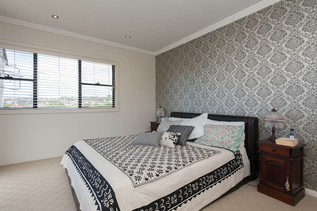 King-size Master bedroom with ensuite and walk-in wardrobes. And large balcony with view