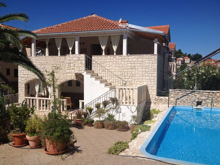 the swimming pool and the house