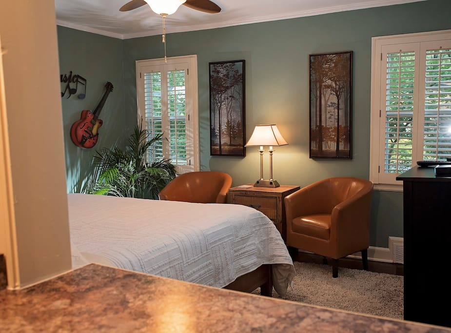Private 1 BR/1 BATH suite for two. Seating area at foot of bed.