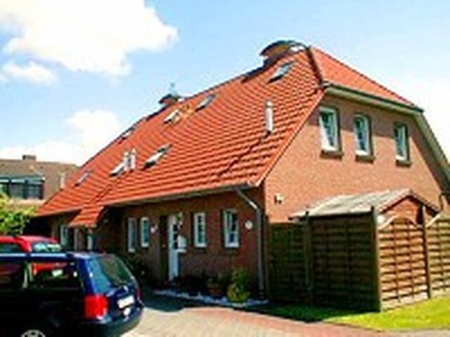 Küstenwohnung mit Kamin - Dornum - Haus