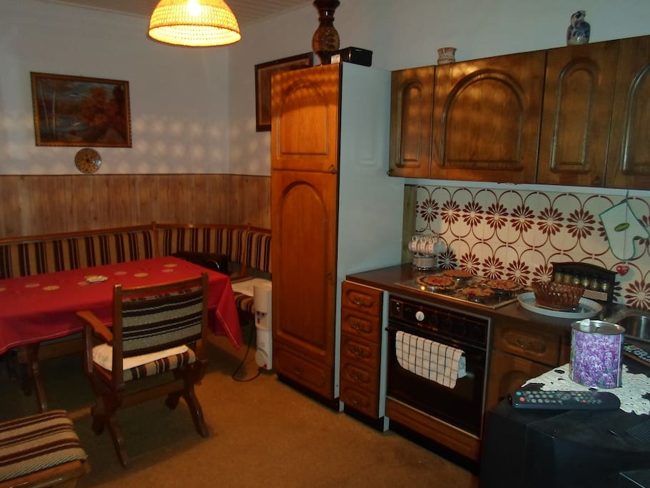 Kitchen made out of oak wood,connected with dining room is great for cooking,eating hanging out with loved ones .