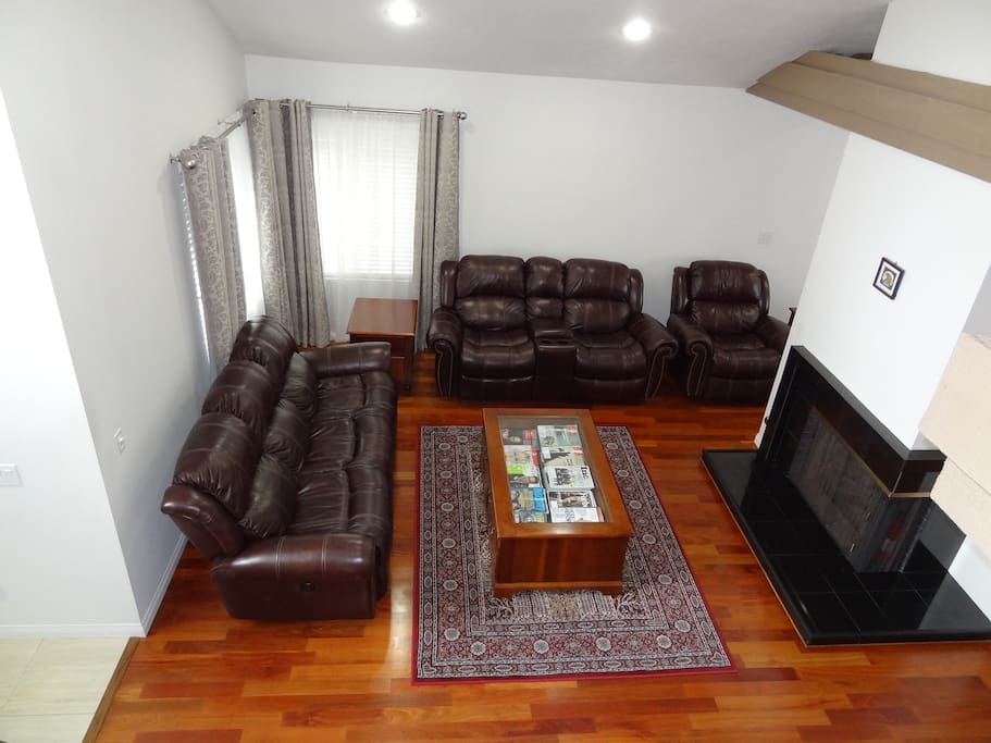 Formal living room with power recliners and copies of business magazines..
