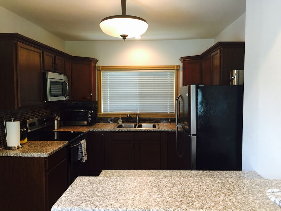 Kitchen has all the amenities of home so you can cook or grill.