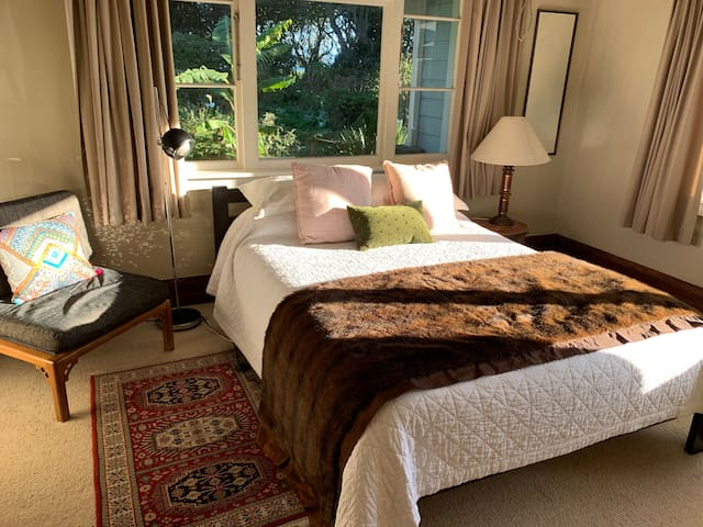 South bedroom with queen bed and ocean views.