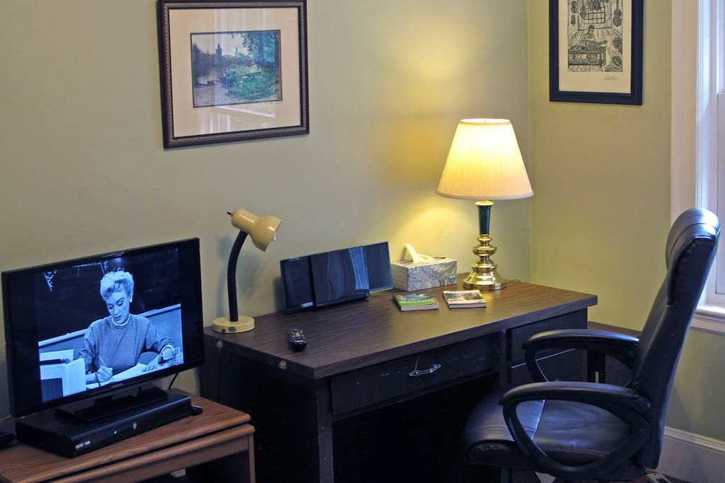 Work area in your private room includes radio/CD player, TV and comfortable office chair.