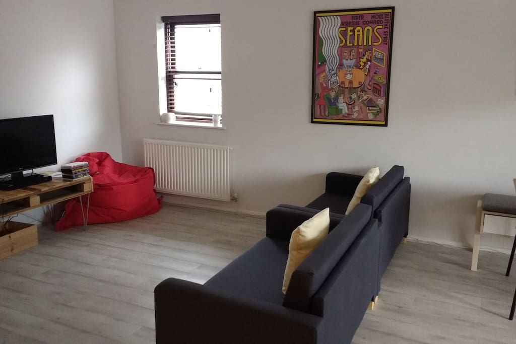 Living Room Area with TV/ DVD Player and selection of DVDs