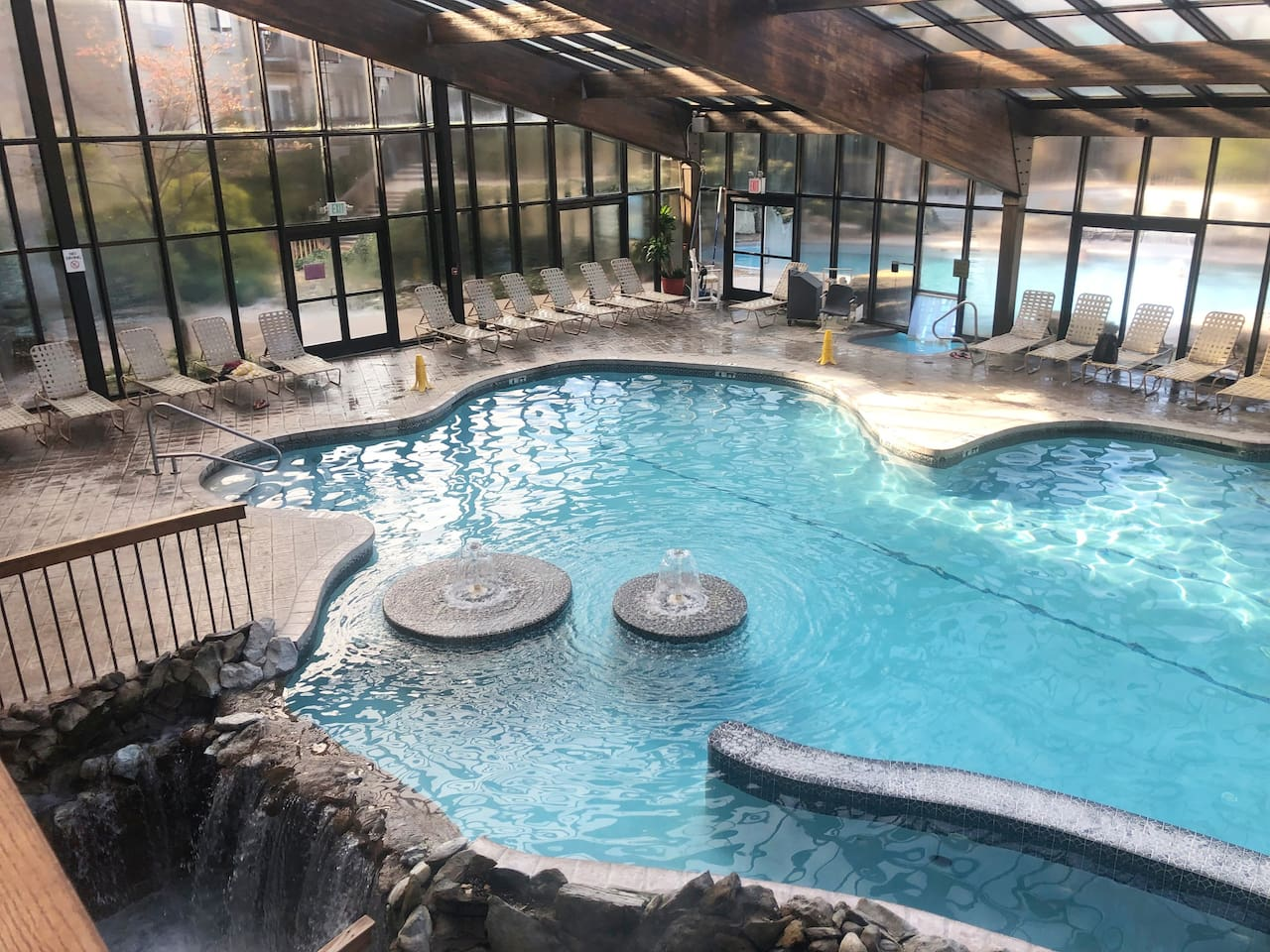 Indoor and indoor / outdoor pools wwater fall and wading pool