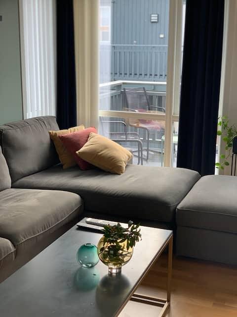 Lys og koselig leilighet med parkering og balkong