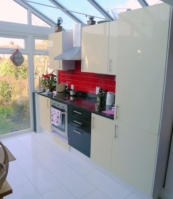 Bright kitchen leading to garden