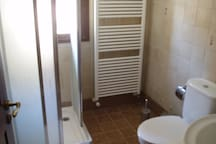 toilet and shower on first servicing  the bedrooms 3 and 4