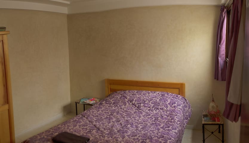 the double-size bed in the bedroom