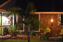 A nighttime view of the front yard.