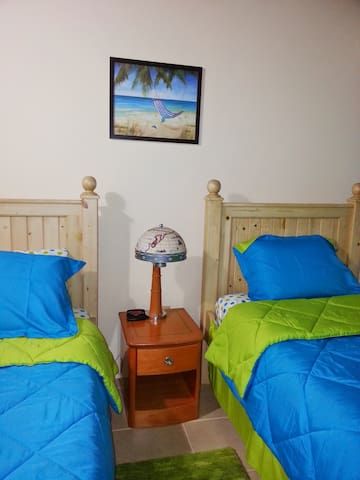 Third bedroom can be used for kids or adults. Has two comfortable twin beds, TV, fan, and ac unit