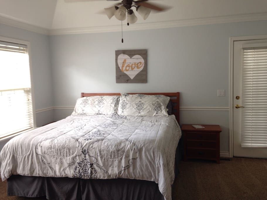 MASTER BEDROOM: has a king bed, outside access to the back deck, French doors that open to a large bathroom with jetted tub.