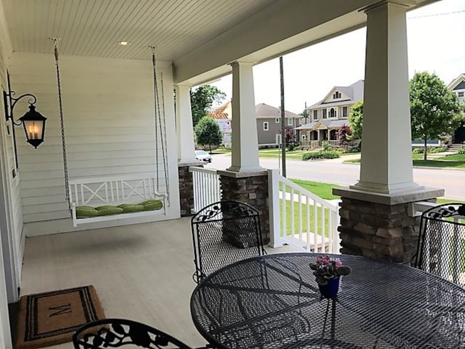 Enjoy the swing or a  meal together on wrap around porch overlooking ND Ave