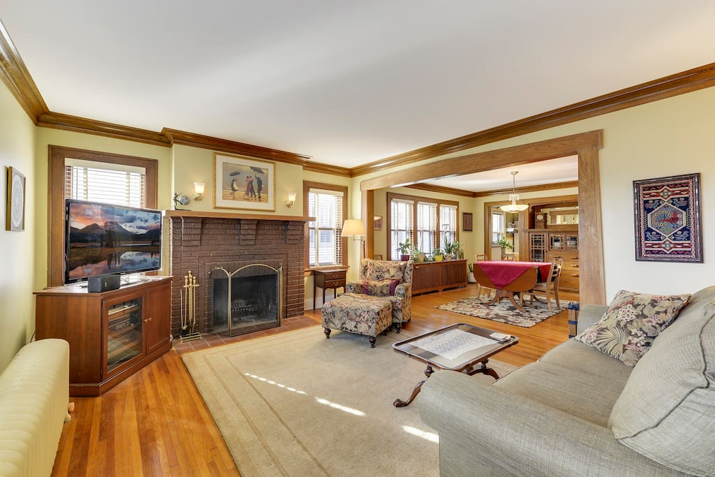 Large living room with wood burning fireplace.