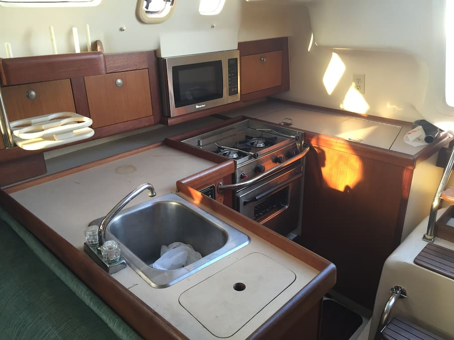 Full galley with gas stove and microwave oven, drink blender & other items upon request